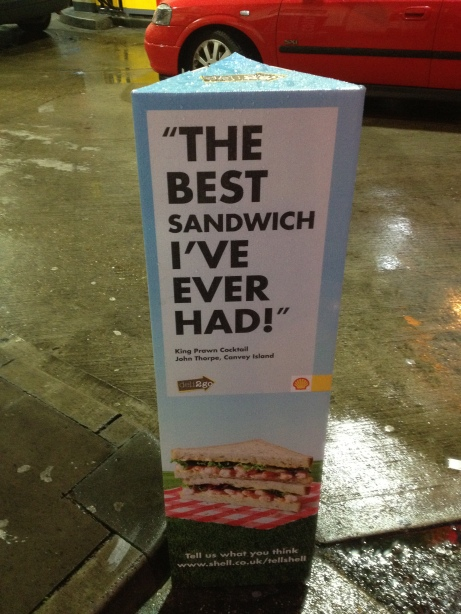 Frankly implausible advertising for sandwiches outside Shell Oil Station, Old St. Islington
