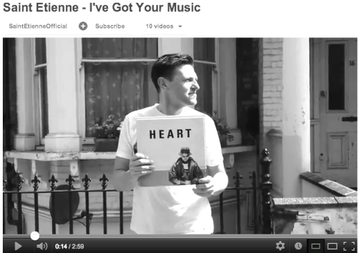 Screenshot from Saint Etienne video showing fan holding a Pet Shop Boys single.