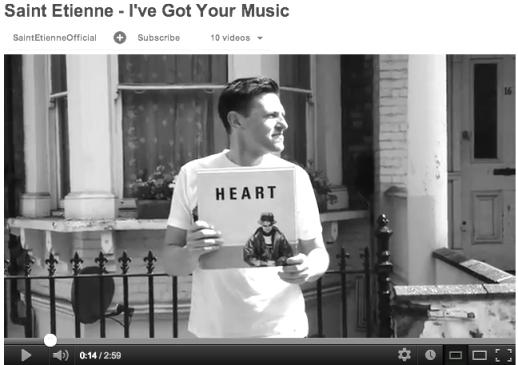 Screenshot from Saint Etienne video showing fan holding a Pet Shop Boys single.
