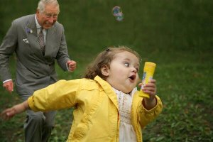 Prince Charles chases girl with bubbles