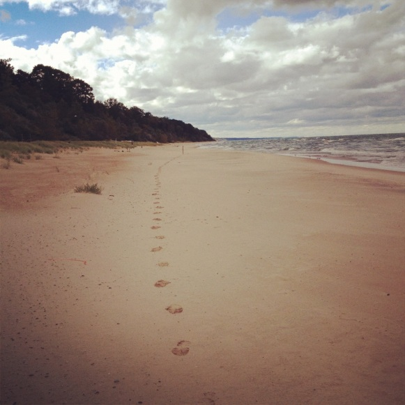 Footprints on beach at Glenn, MI.